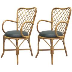 Two French Mid-Century Rattan Side or Desk Chairs Attributed to Jean Royère
