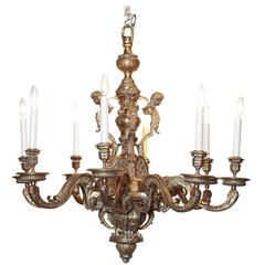 19th Century French Bronze Eight-Light Chandelier with Cherubs and Other Motifs