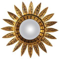 Spanish Mid-20th Century Giltwood Sunburst Mirror with Carved Decorative Details