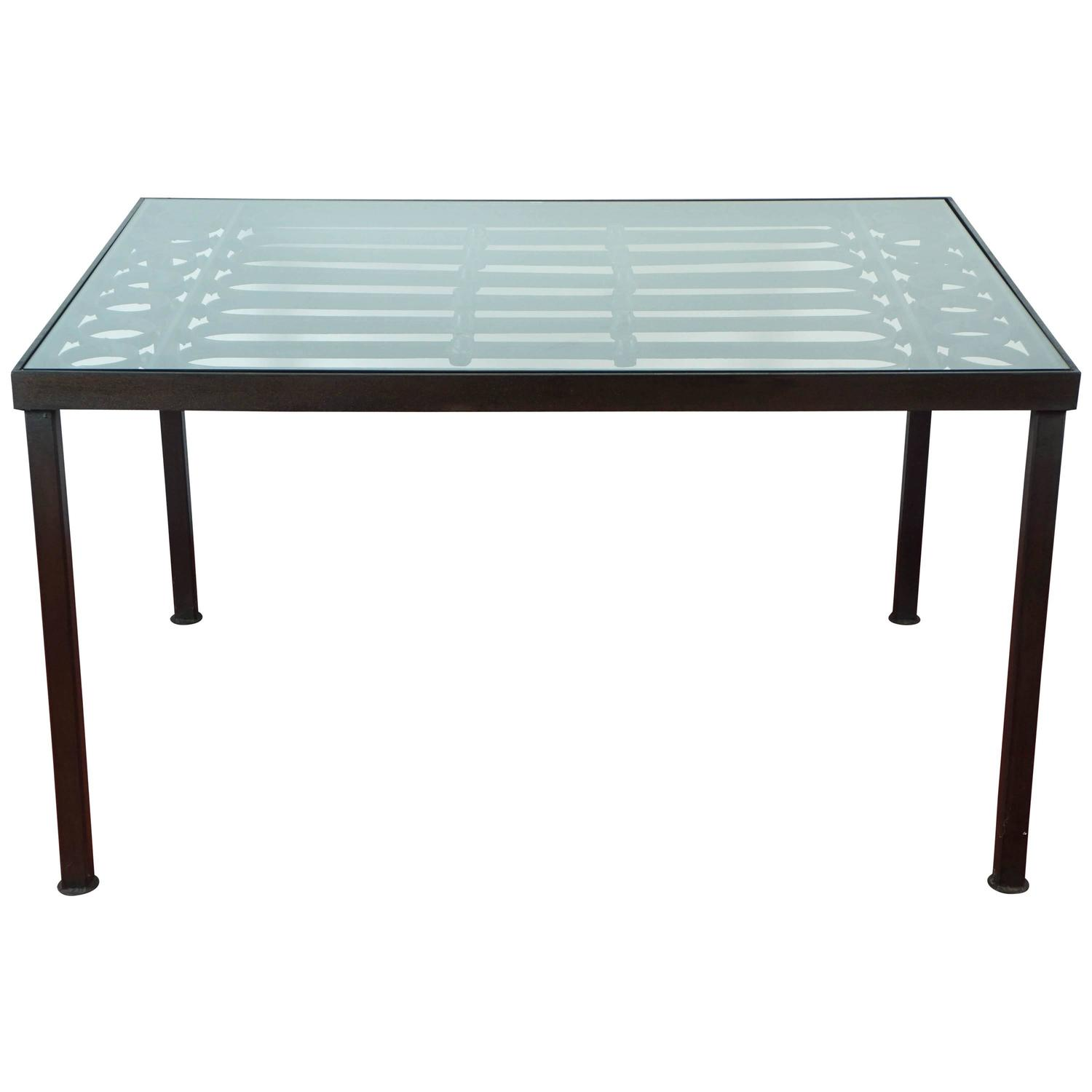 Wrought iron and glass indoor outdoor dining table for for Glass top outdoor dining table