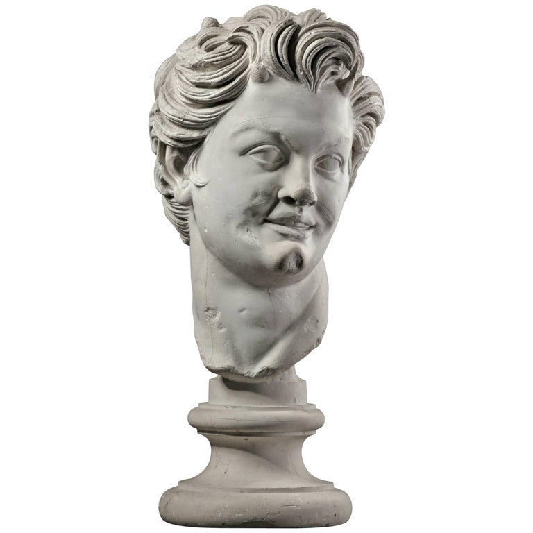 Large Plaster Bust of a Young Man on a Socket For Sale
