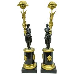 Pair of French Gilt and Patinated Bronze Figural Candlesticks