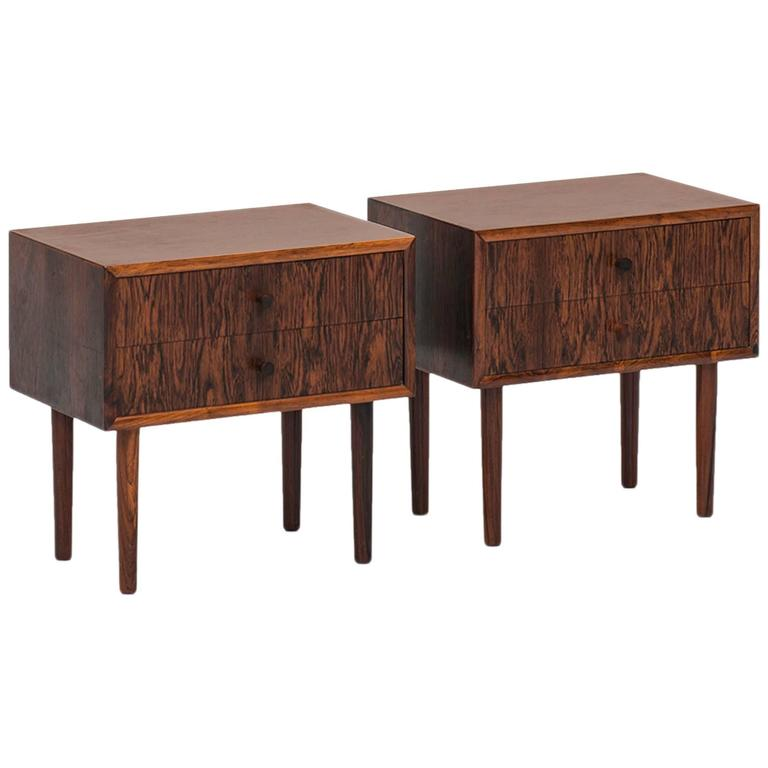 A pair of bedside tables in rosewood produced in Denmark