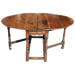 English Late 18th Century Oval Yew Wood Drop-Leaf Dinning Table