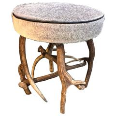 Antler stool with grey cowhide