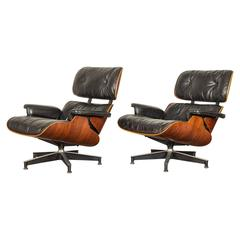 Pair of 1959 Eames 670 Rosewood Lounge Chairs and Ottoman