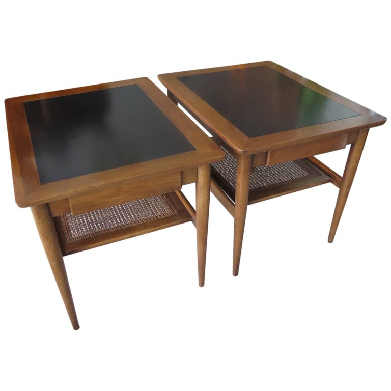 A Pair of American of Martinsville Occasional Tables with Caned Shelf For Sale