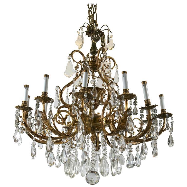 Bronze and Crystal Twelve-Light Continental Chandelier