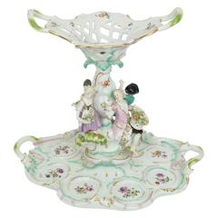 Meissen Figural Centerpiece with Basket on Top and Cherubs Around