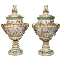 Pair of Porcelain and Bronze Capodimonte Figural Urns with Ram's Head