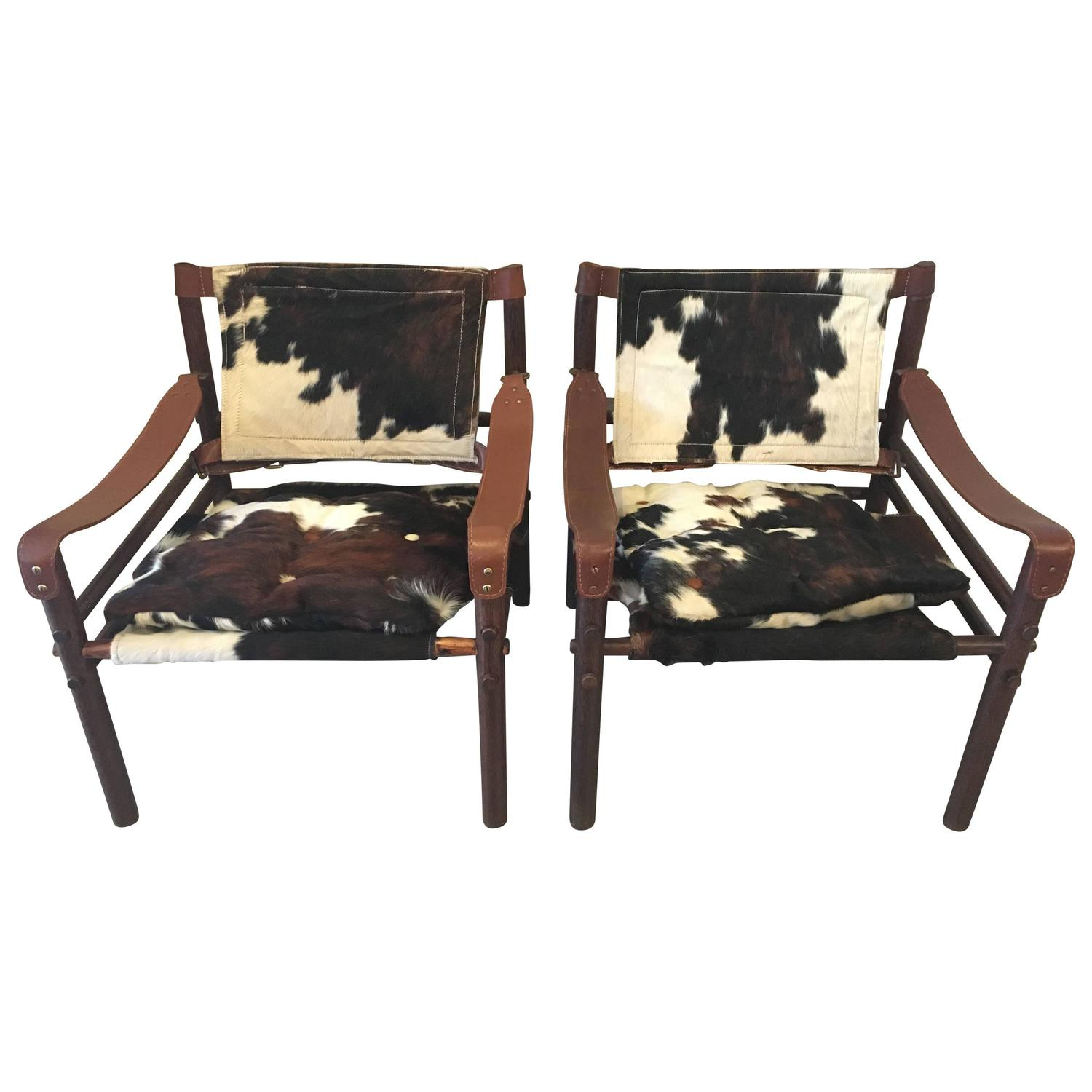 """Pair Of Arne Norell """"Sirocco"""" Safari Chairs In Cowhide At"""