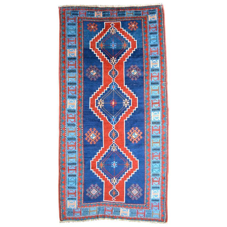 Early 20th Century Handwoven Wool Blue Caucasian Kazak Rug