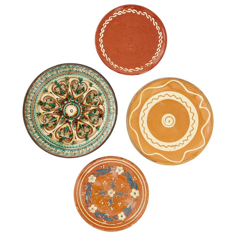 Set of Four Glazed and Hand-Painted Terracotta Serving Plates, Sweden and Italy