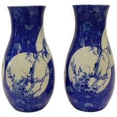 Pair of Japanese Blue and White Baluster Vases with Shaped Panels of Animals