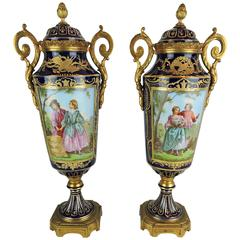 Pair of French Sevres Style Porcelain and Gilt Bronze Lidded Baluster Urns