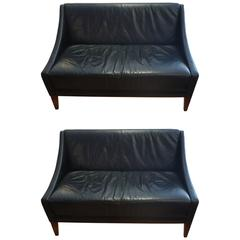 Pair of Sleek Mid-Century Modern Black Leather Loveseats