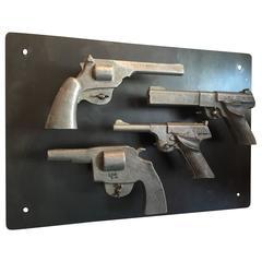 Four Cast Aluminum Pistol Set
