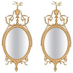 Pair of Oval Mirrors in the manner of Robert Adam