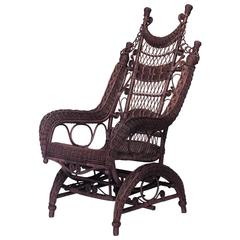 19th Century American Ornate High Back Wicker Rocking Chair by the Heywood Bros.