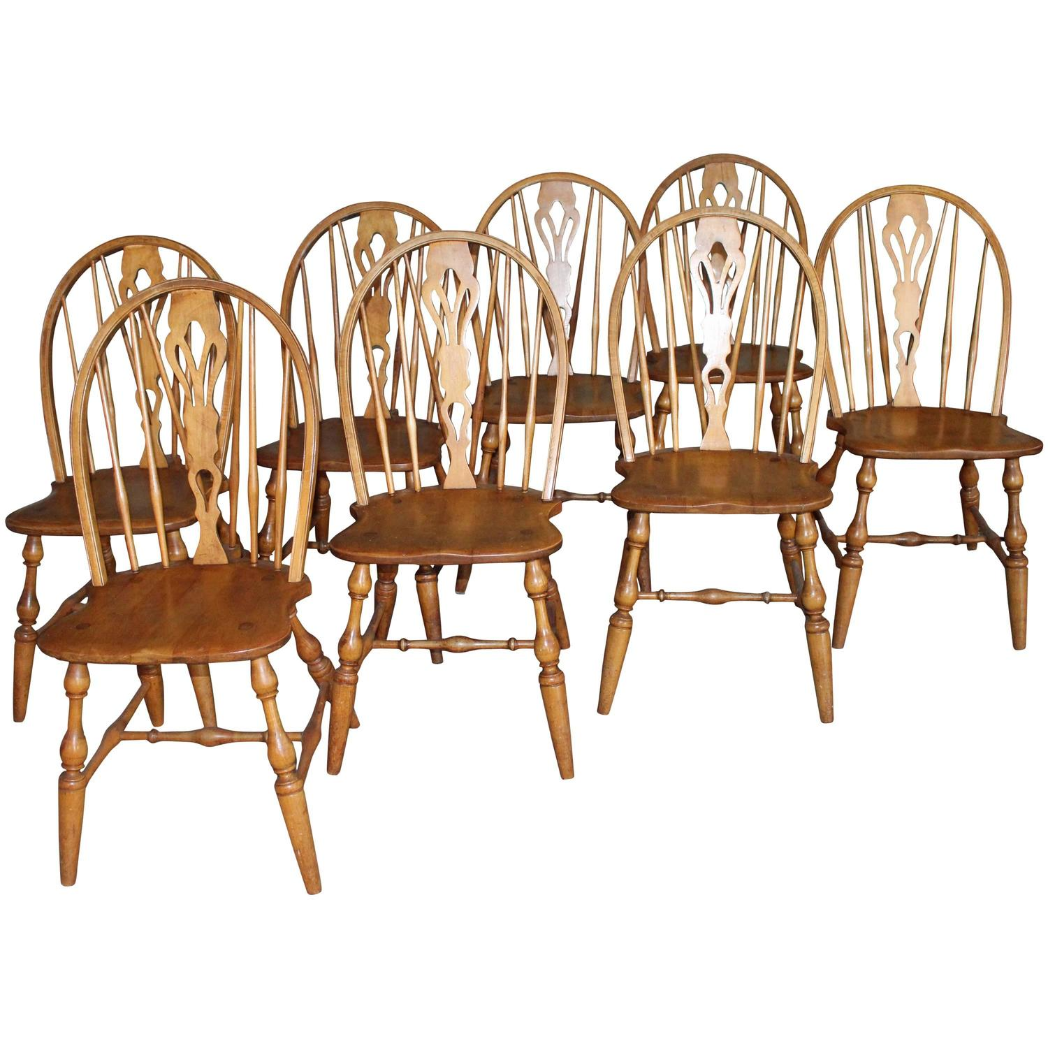 english windsor bow-brace back dining chairs with decorative splat