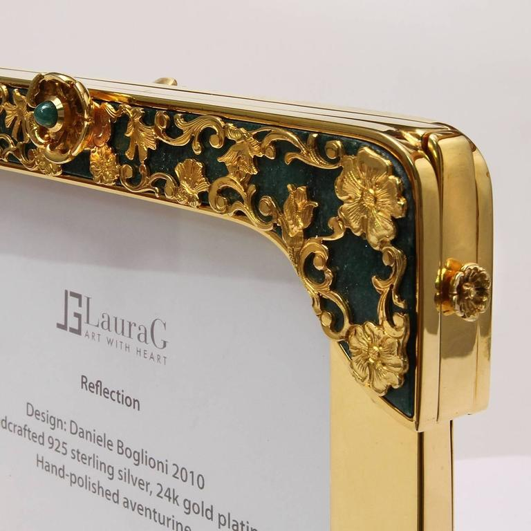 Reflection is a golden silver floral double frame with aventurine stone, a jewel picture frame signed Laura G Art with Heart. It is handcrafted in 925 sterling silver golden and it is the first piece of the collection Art with Heart, delicately
