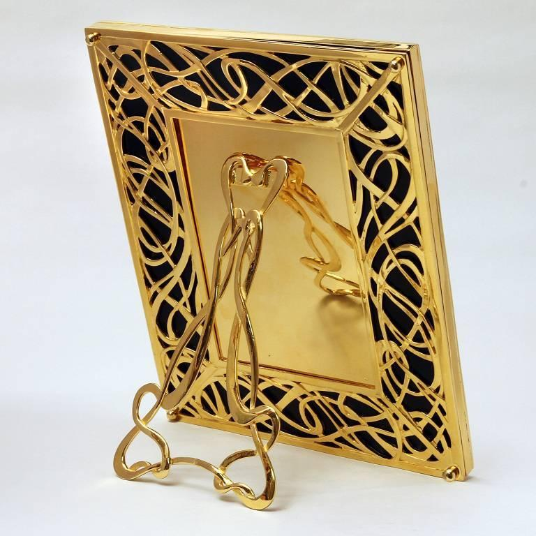 Illumination is a rectangular golden silver picture frame with black marble designed by Laura G Art with Heart and it is decorated 360°, both front and back as every one of my picture frames.. A Classic Tiffany motif meanders in relief on a