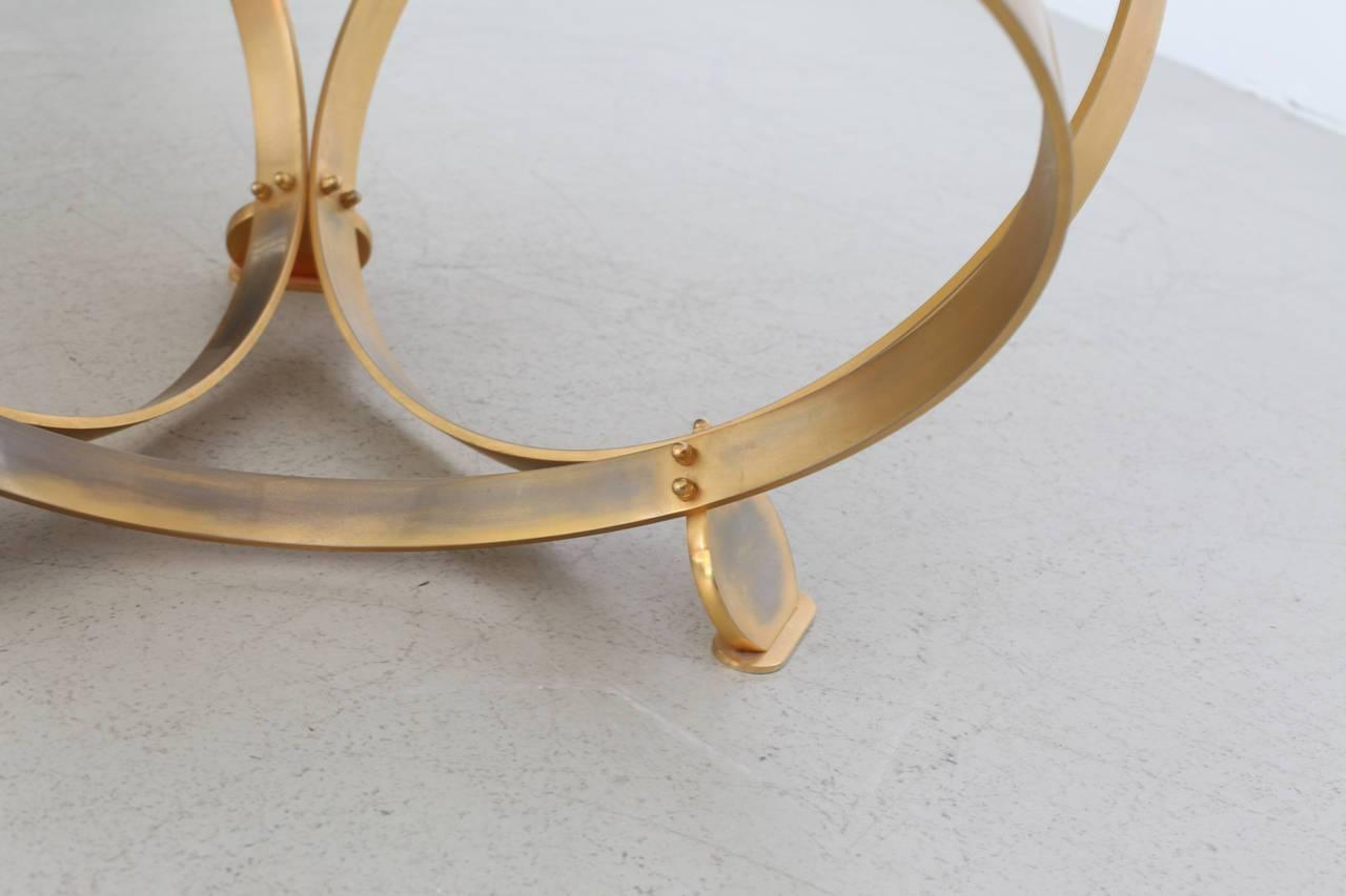 Round brass geometric rings coffee table with glass top for Round glass coffee tables for sale