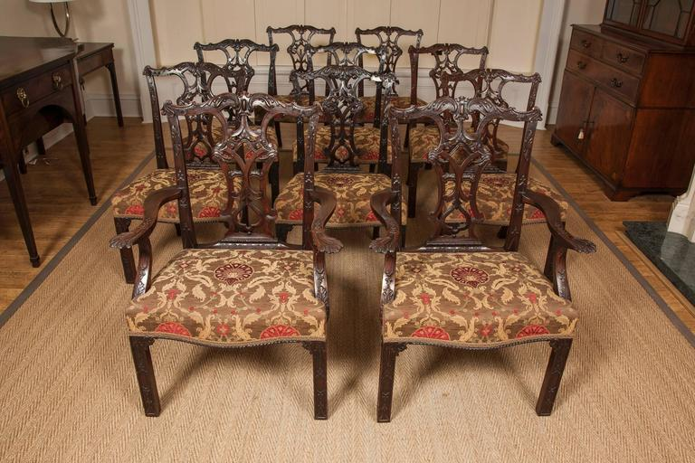 This superb set of chairs in the Chippendale manner with carved and pierced splat backs, serpentine front seat rails, blind fret moulded front legs and splay back legs. The two carvers with wonderful carved outswept arms and supports. Of