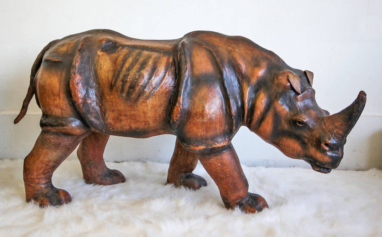 A monumental leather rhinoceros. The sculpture is incredibly beautiful, made from a wooden frame and clad completely in leather with incredible attention to detail. The rhino still has his original tail, ears and glass eyes.  Unlike most other