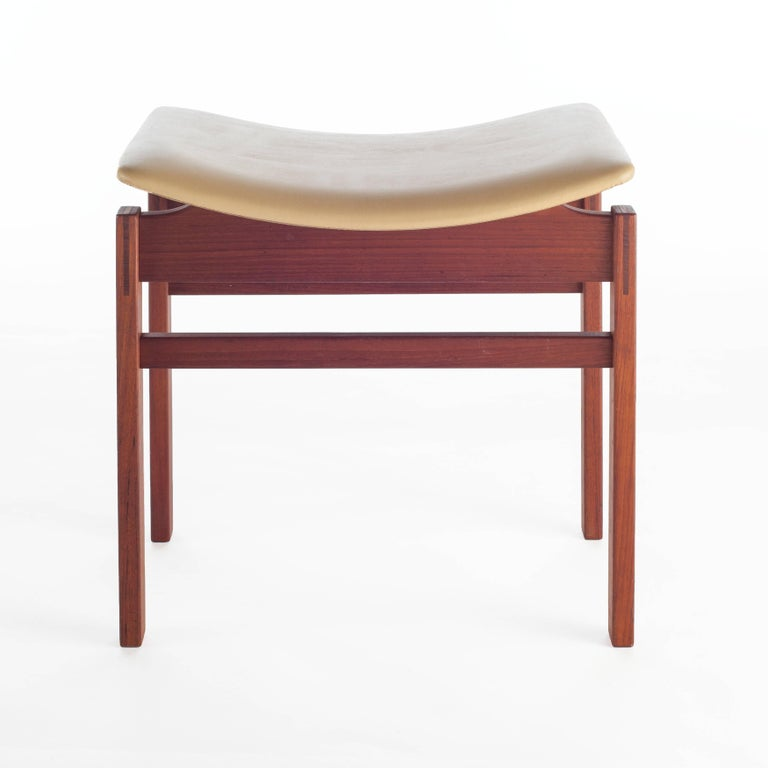 Lightweight yet sturdy, this versatile set of stools can be used in a variety of settings. The butter-yellow leather on the curved seats contrast nicely with the rectangular lines and warm tones of the walnut frames.   Single stool for $2500.
