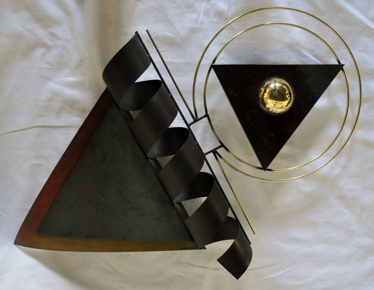 Dimensional mixed metal wall sculpture by Curtis Jere. Signed and dated 1993