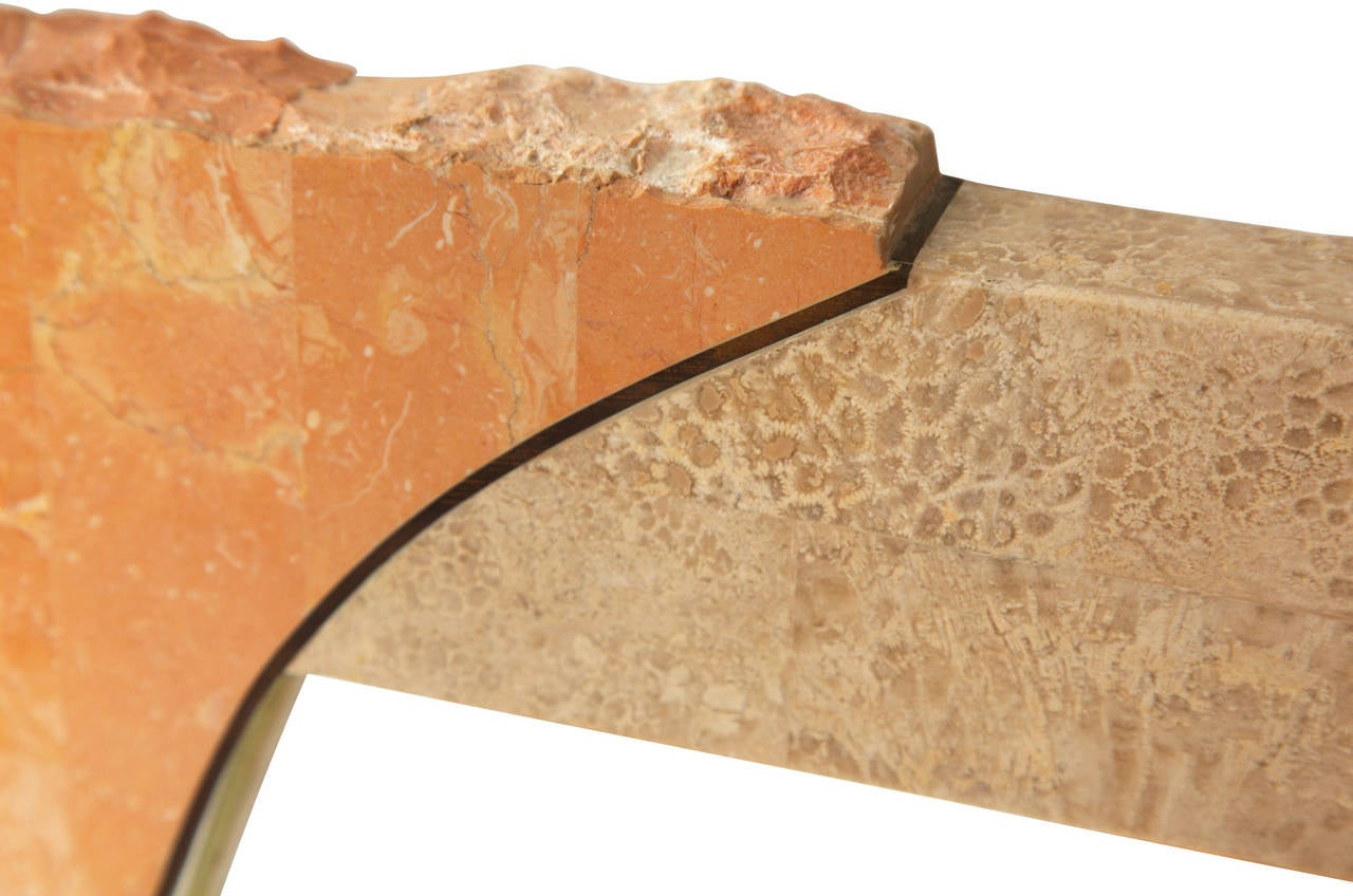 Large modern tessellated coral marble and travertine stone wall mirror with brass inlay.  In the style of Maitland-Smith.
