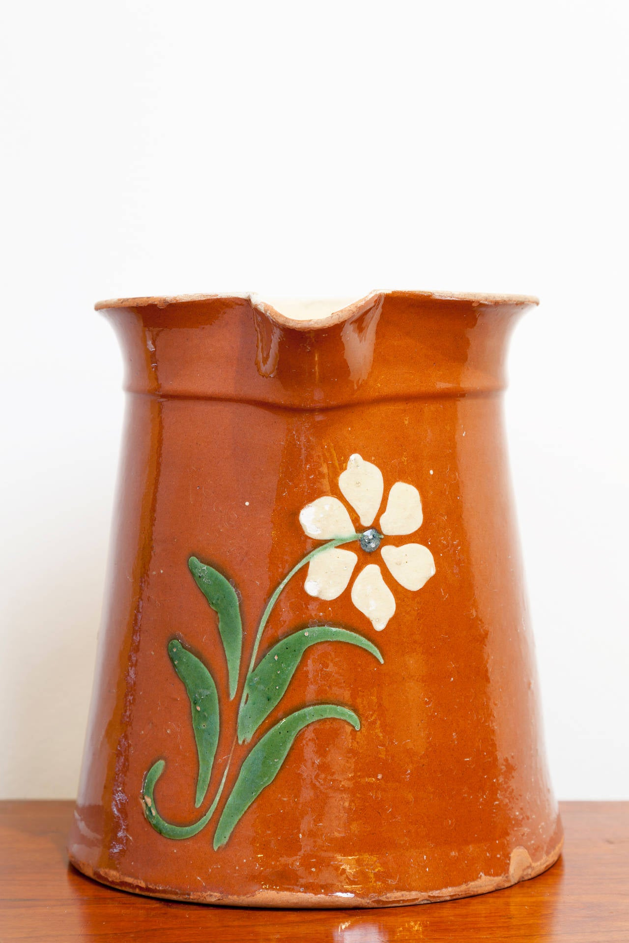 French Savoyard Pitcher, circa 1900. Slipware flower design in green and cream on a terra cotta glaze.
