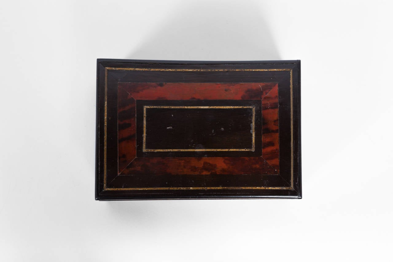 Tortoiseshell and lacquer box with brass inlay, circa 1900, England.