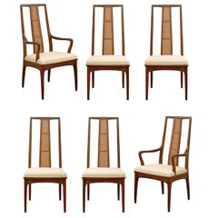 Elegant Set of Six Walnut and Cane Dining Chairs by John Stuart