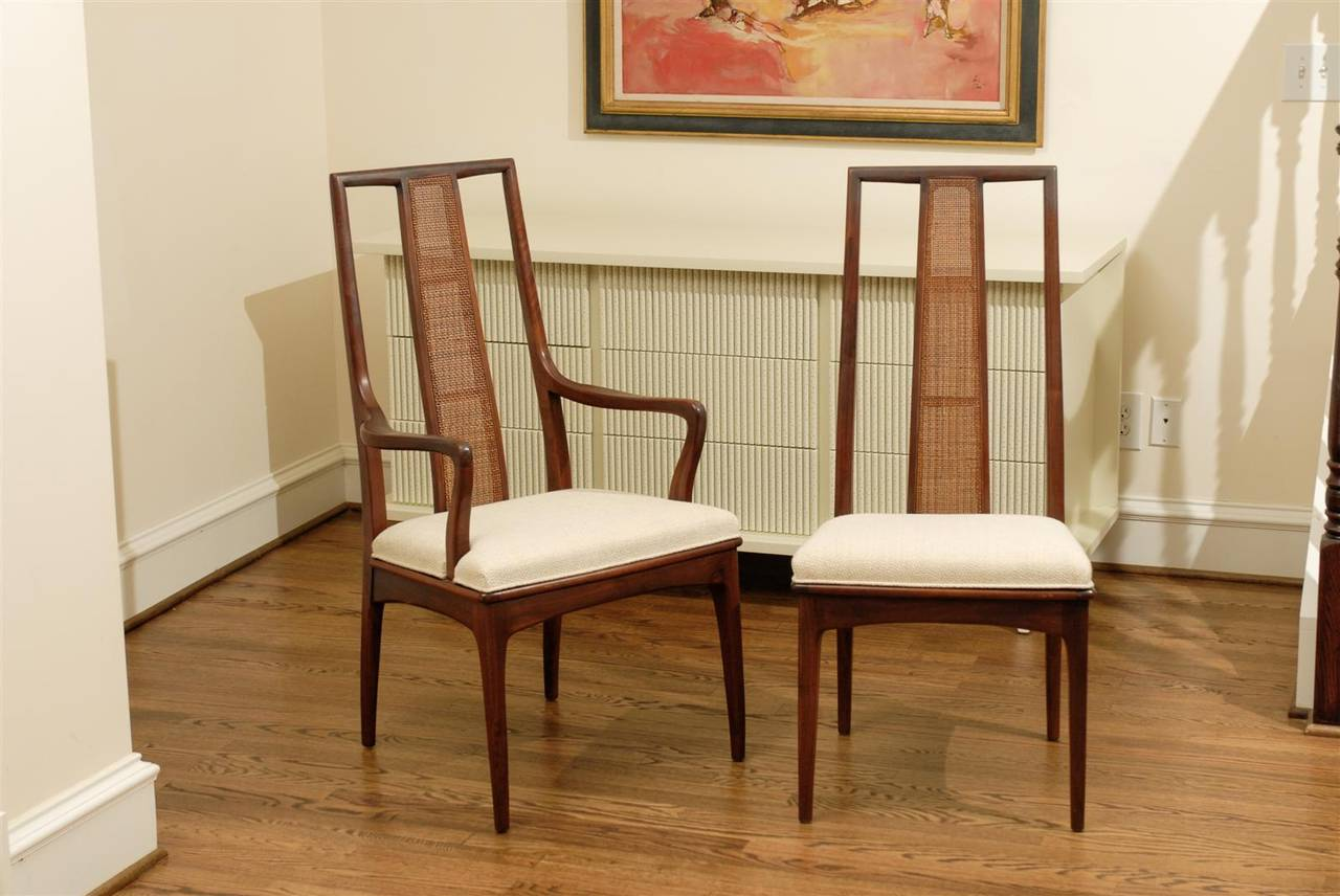Mid-Century Modern Elegant Set of Six Walnut and Cane Dining Chairs by John Stuart For Sale