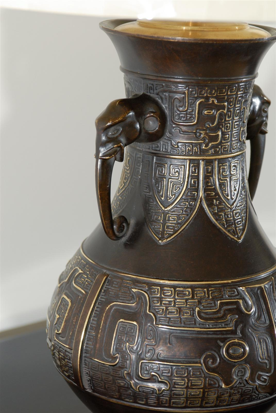 Exceptional Pair Of Cast Urn Lamps With Elephant Head