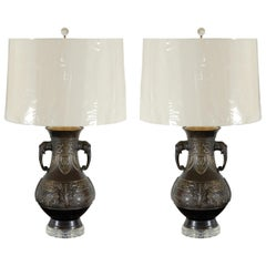 Exceptional Pair of Cast Urn Lamps with Elephant Head Detail