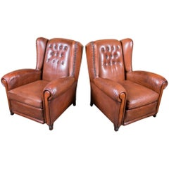 Pair of French Leather Tufted Wing Chairs with Reversible Cushions and Nail Trim