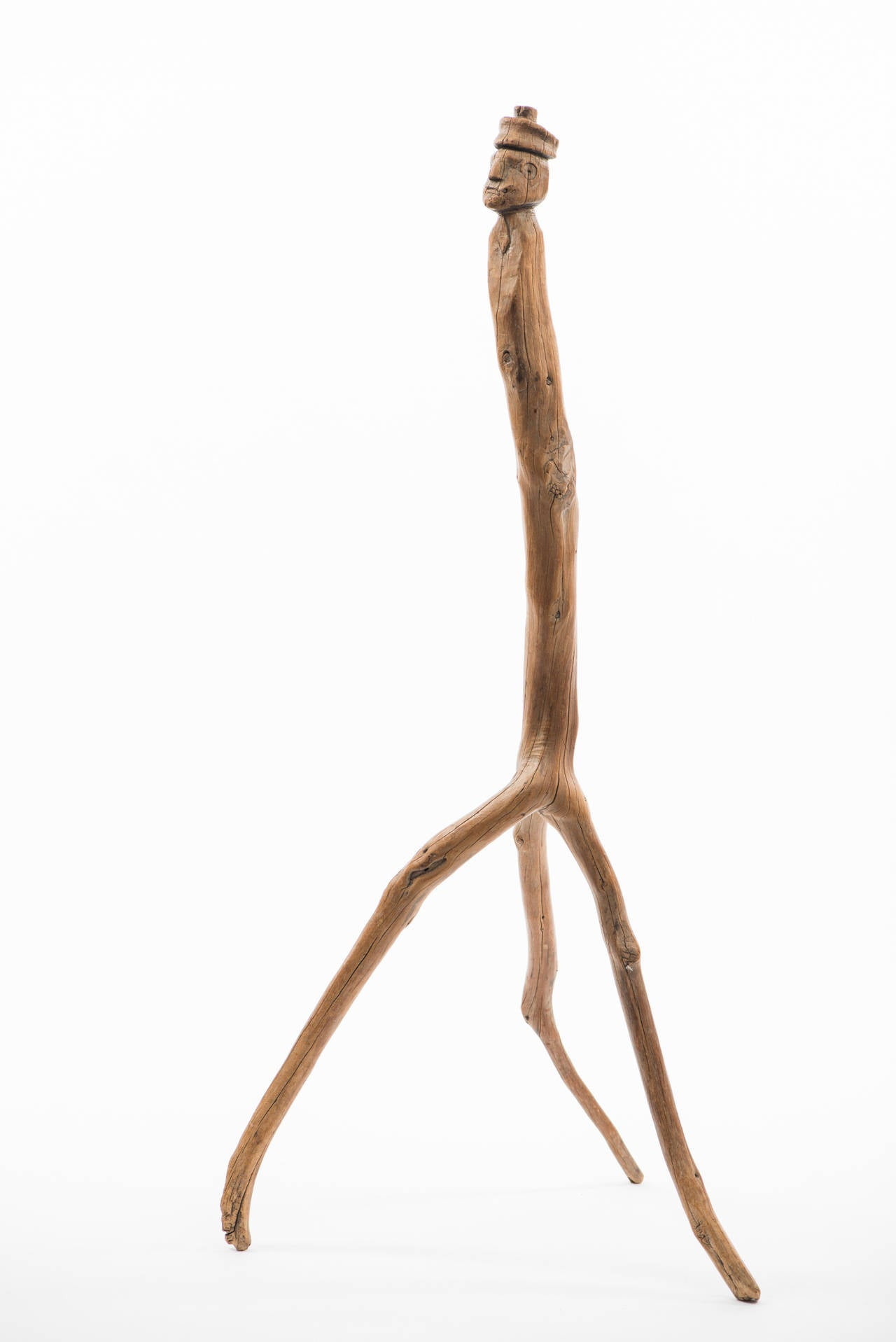 """Carved Folk Figure Cane with Branch Legs  Region: American - Southwest?  Circa: Early 20th Century  Material: Native branch form with carved trunk  Dimension: Approximately 38""""  Condition: Excellent. No restoration  Collection"""