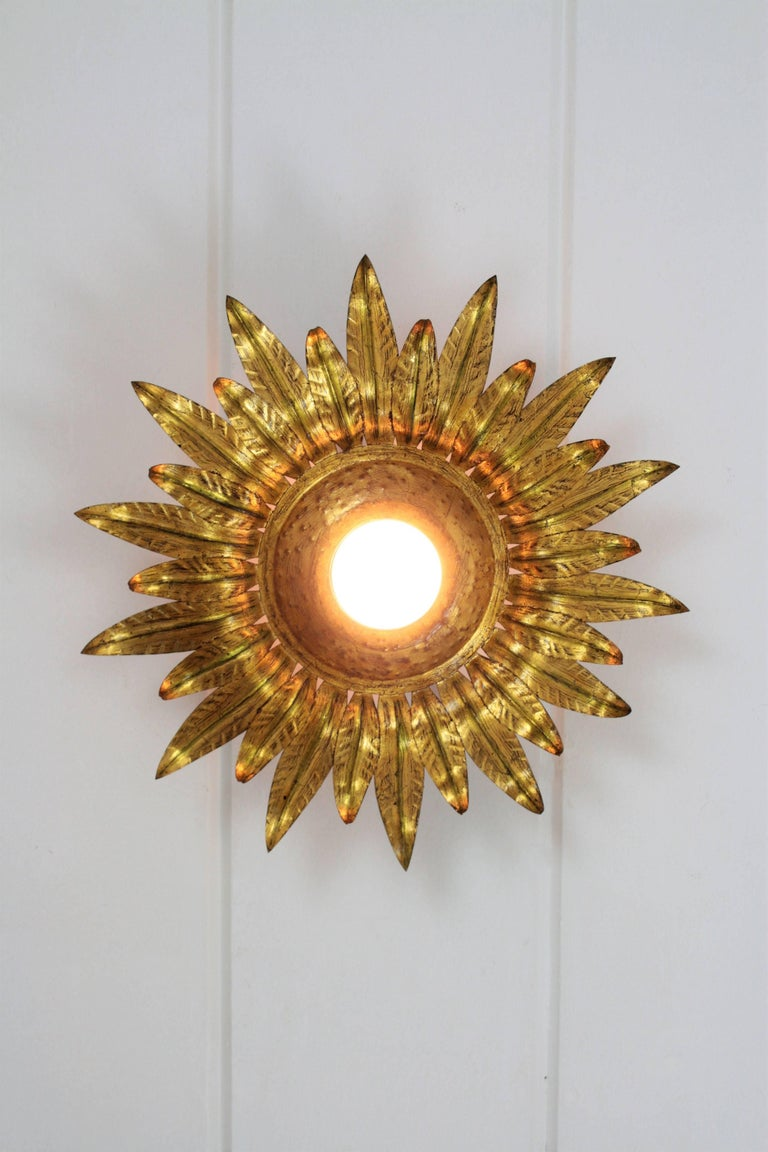 Spanish Midcentury Gilt Metal Sunburst Flower Shaped Light Fixture with Green Accents For Sale