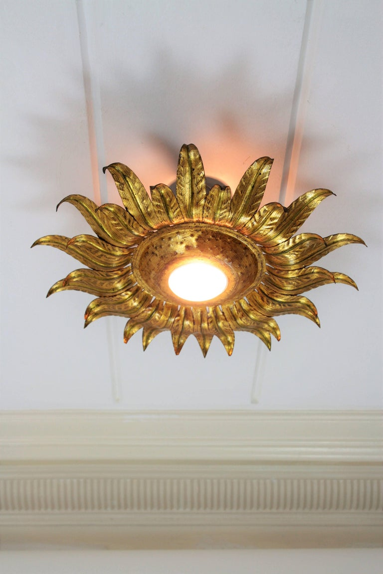 20th Century Midcentury Gilt Metal Sunburst Flower Shaped Light Fixture with Green Accents For Sale