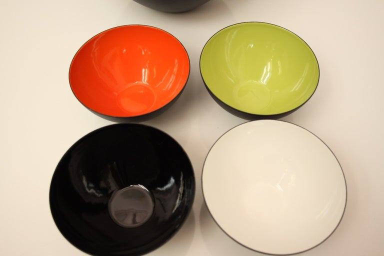 Herbert Krenchel midcentury / Danish modern set of unused or near mint condition bowls, a large matte glaze bowl with enameled green interior and four en suite smaller bowls with red, black, white and green interiors and set of composite salad
