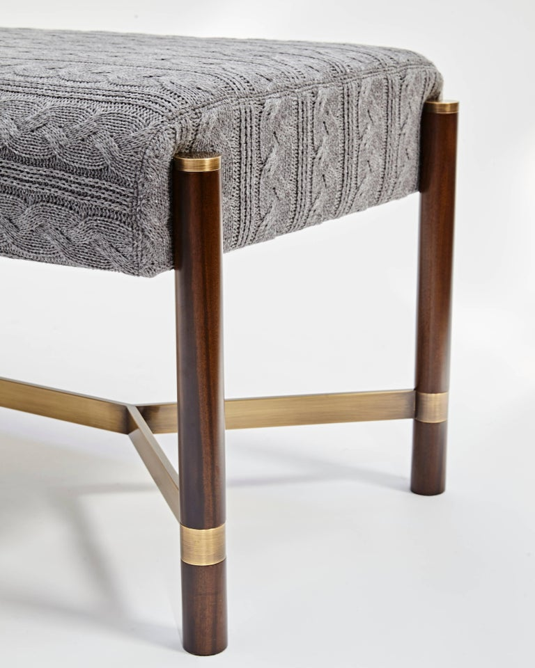 This bench is made of Brazilian imbuia wood with Brass details, it draws inspiration from the 1970s design and a very elegant combination of wood and brass. The legs are in solid wood and the details in stainless steel brass like finishing.  Seat