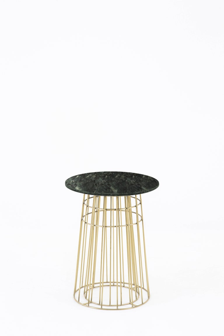 Contemporary delicate piece of art work in massive brass and Brazilian granite stone. The object was exposed in São Paulo and Paris, and was selected to appear in fashion and design review as Casa Vogue. It can be used alone as a side table or