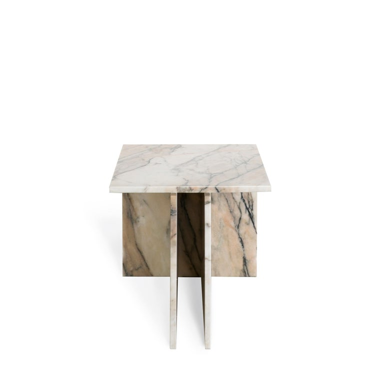 The THÈ table is a versatile table that can be used as a side table or coffee table.  Two vertical planes join to another plane, composing a T-shaped base for the top of the table. Produced in marble, it can be used in pairs (require 02 items to