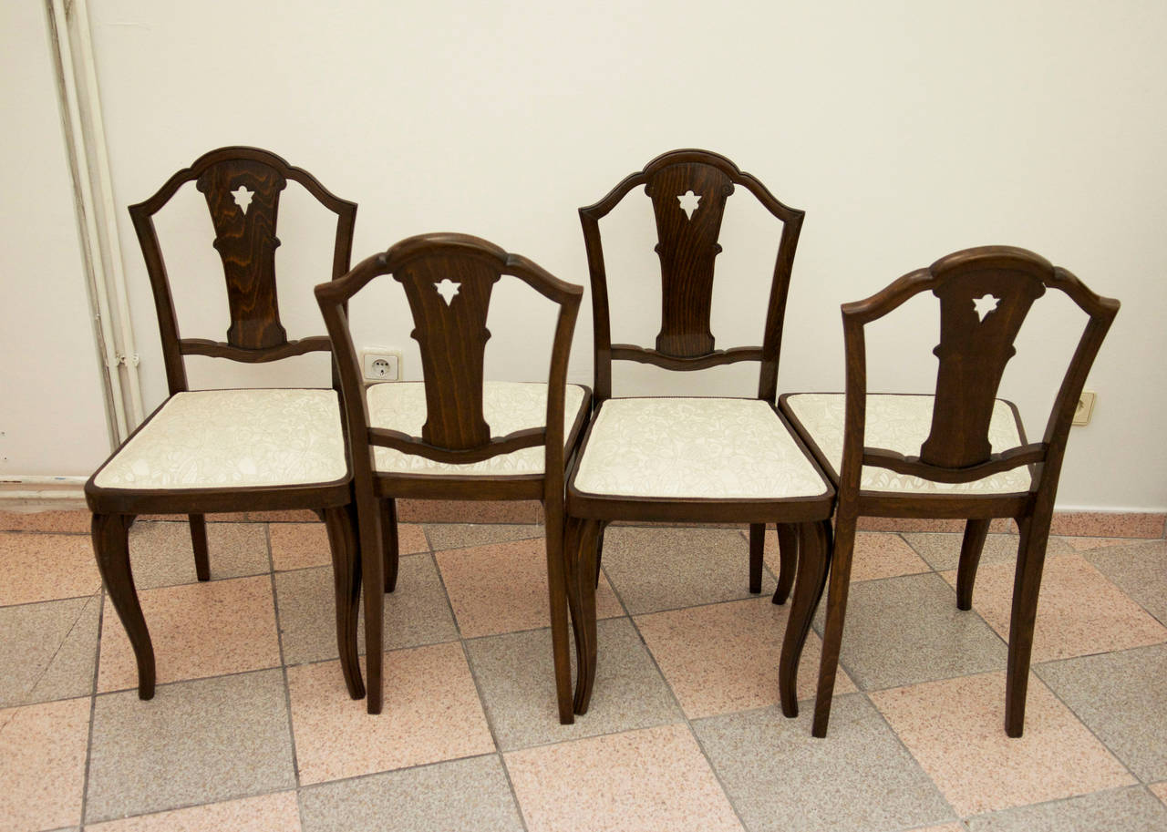 Set of four rare Thonet chairs attributed to Otto Prutscher. Fully restored, shellack polish, upholstered with Backhausen fabric