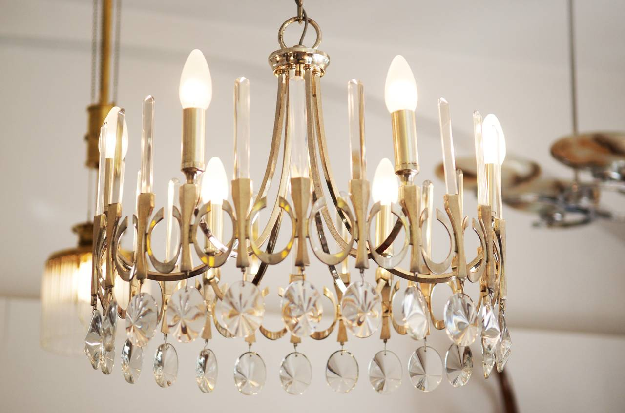 1960s chandelier by Gaetano Sciolari in silverplate and crystal,  with six arms. Excellent overall condition. Diameter: 47 cm (18.50in) Heigh: about 70cm (27.55in)