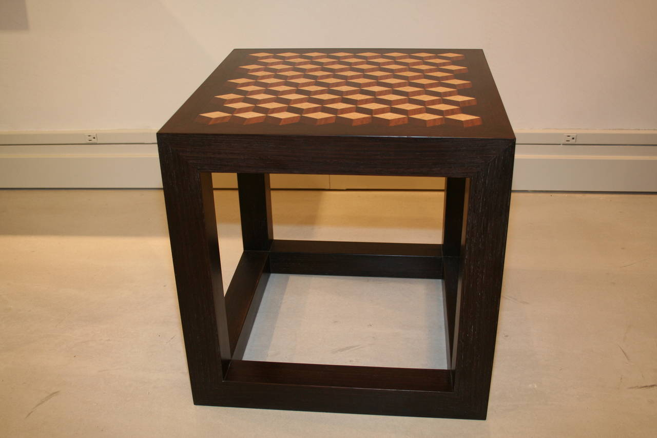 Emily Summers Studio Line contemporary table is cut from solid stock and enriched with geometric inlay detail. This prototype can be custom designed and ordered as a pair.  The primary veneer is Wenge with marquetry of various woods.
