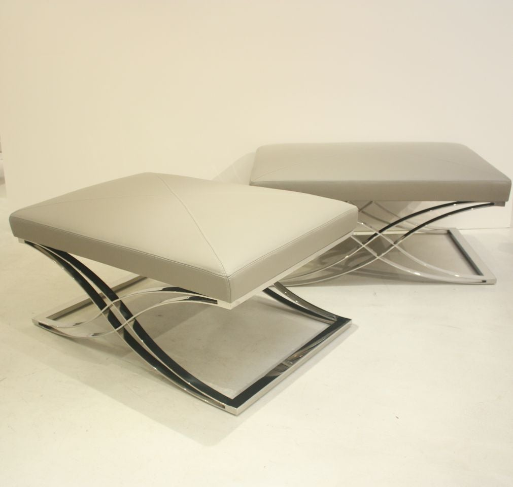 Pair of benches made by the Italian furniture design company, Cecchini. The benches have chrome bases and leather cushions that are newly upholstered in Jamie Stern Danbury Grey leather.